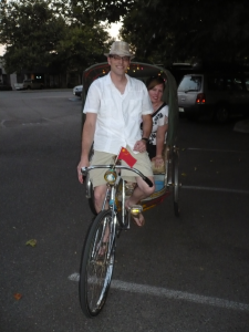 Ian takes his wife Heather for a test ride in the rickshaw.