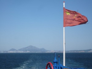 As we head South on the ferry, Dalian disappears into the horizon.