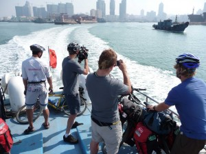 Leaving Qingdao...Team Man Zou in action on the back of the boat.